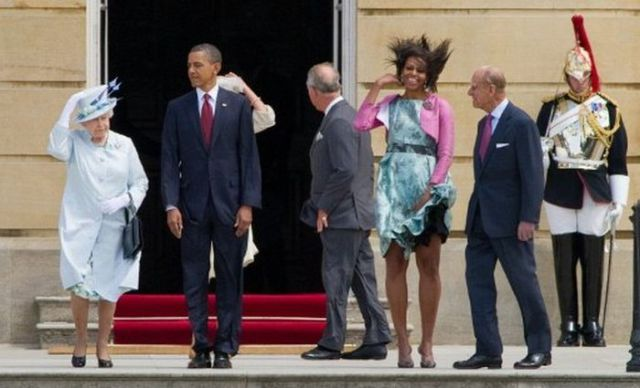 """Britain's Queen Elizabeth II (L), US President Barack Obama (2nd L), US First Lady Michelle Obama (3rd R) and Prince Philip, the Duke of Edinburgh (2nd R) watch a Guard of Honour at Buckingham Palace, in central London, on May 24, 2011. US President Barack Obama Tuesday basked in the lavish royal pageantry of a state visit to Britain, given an extra dash of glamour by a brief encounter with Prince William and his bride Catherine. But the 24-hour demands that follow a US president everywhere shadowed the London pomp, as Obama took time out to say he was """"heartbroken"""" at the toll of vicious tornados which ripped across the US midwest, killing 116 people. AFP PHOTO / LEON NEAL"""